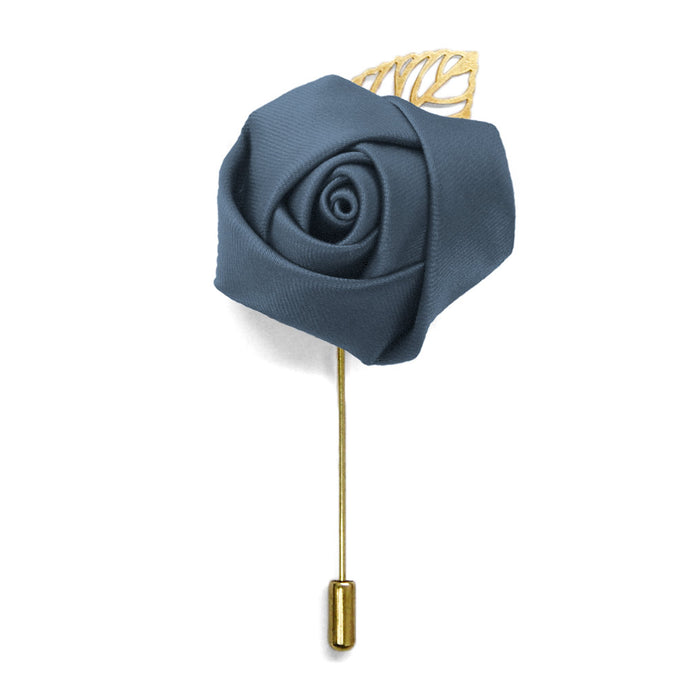 Lapel pin with a dusty blue flower and gold tone leaf and pin