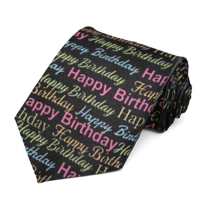 An assortment of happy birthday text on a black tie.