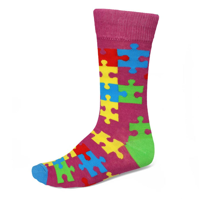 men's colorful scattered puzzle piece socks on a purple-pink background