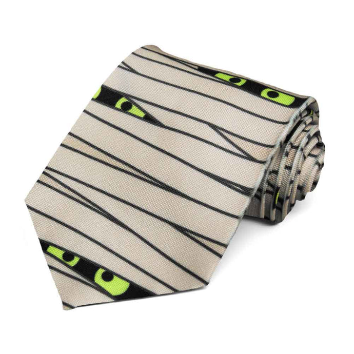 Mummy wraps and monster eyes on a beige tie.