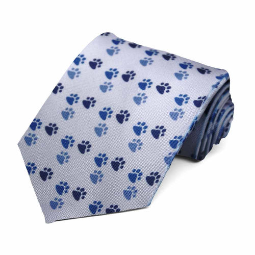 Darker blue paw prints on a light blue tie.