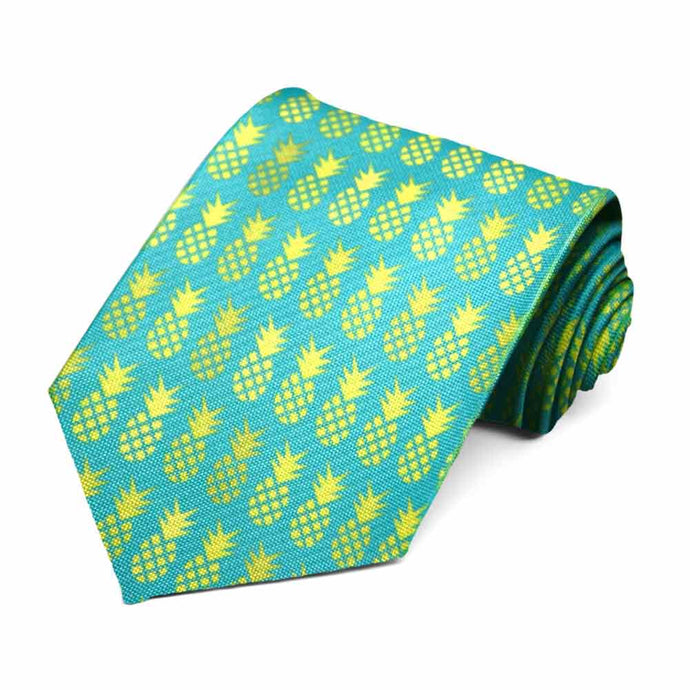 An aqua tie with florescent green pineapples.