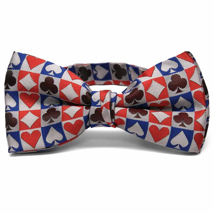 Blue, red, and burgundy card suit bow tie on white background.