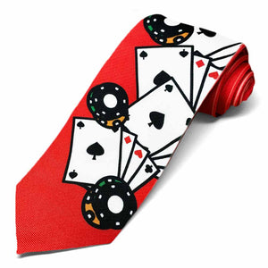 Poker chips and cards on the bottom section of a red tie.