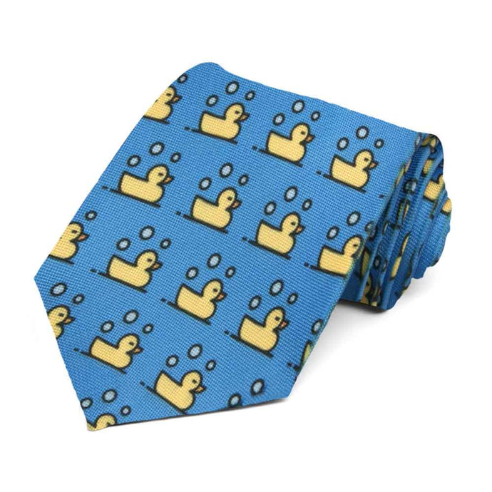 Yellow rubber ducks on a blue tie.