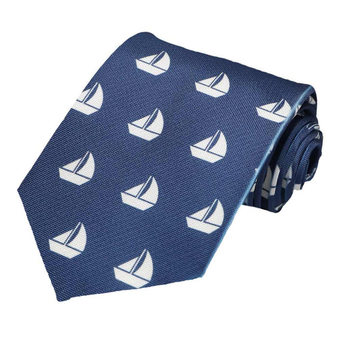White sailboats on a navy tie.