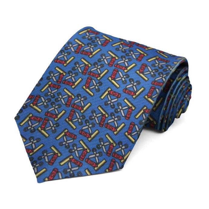 School supplies on a blue tie.