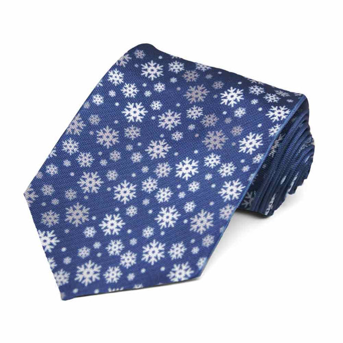 A random display of white snowflakes on a dark blue tie.