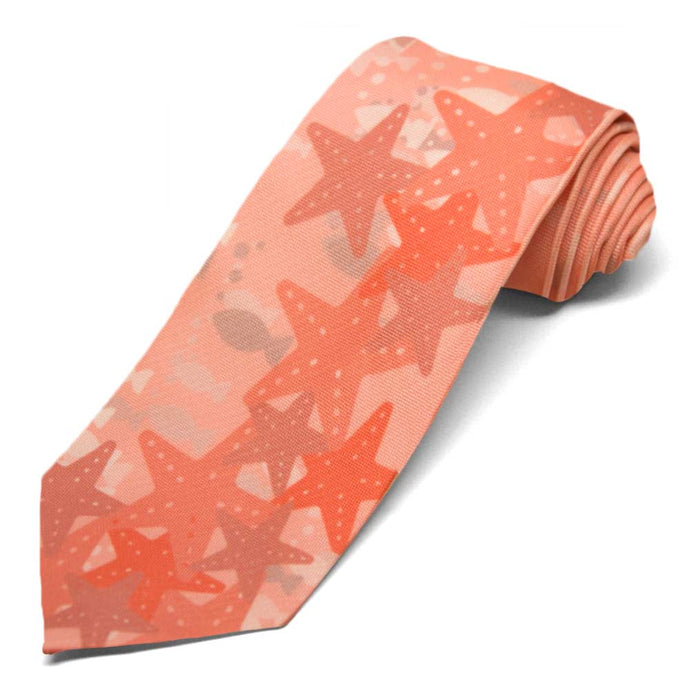 Coral starfish and fish on a lighter coral tie.