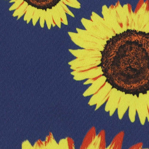 Closeup of a sunflower pattern on a dark blue background