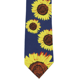 Flat dark blue necktie with scattered sunflowers on it