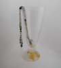 Tourmaline and gold bead necklace in hand blown champagne glass