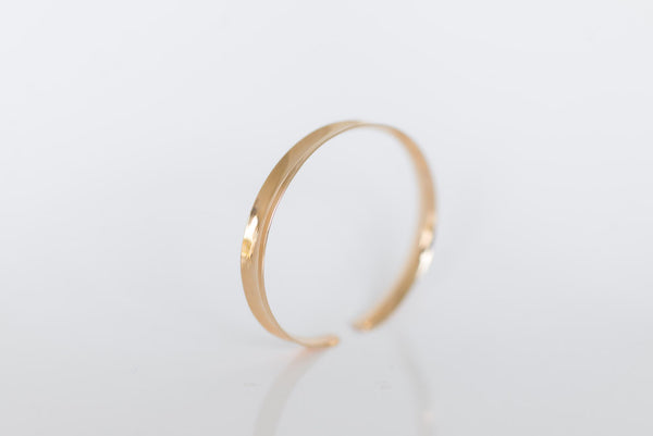 Channel: Gold Anticlastic Bracelet Narrow