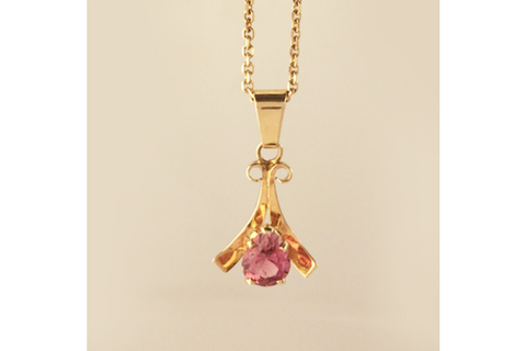 A Blushing Pink Tourmaline Pendant in 14k Yellow Gold