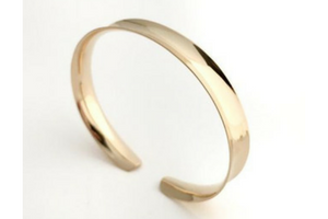 Channel: Gold Anticlastic Bracelet Medium