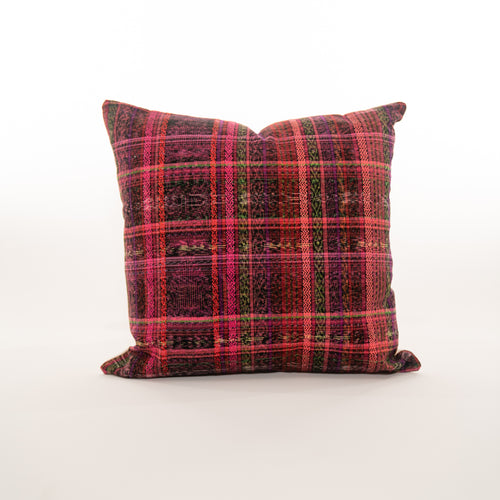 bright pink pillow made from Guatemalan textiles