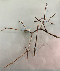Art with sticks, rocks and wire inspired by Andy Goldworthy