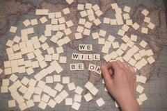 "Scrabble tiles spelling ""We Will Be Okay"""