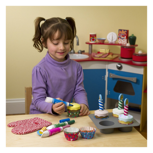 Child playing with Bake & Decorate Cupcake Set