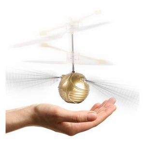 Hand guiding Harry Potter Snitch Heliball