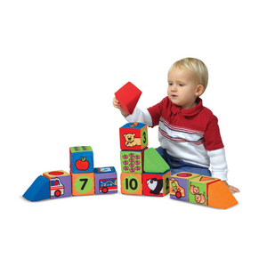 Child playing with Match & Build Soft Blocks