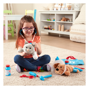 Child playing with Pet Vet Play Set.