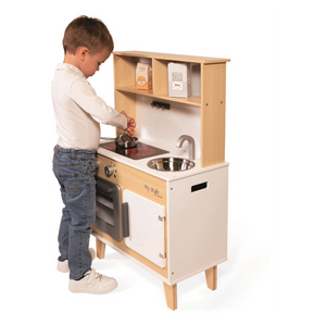 Child playing with kitchen