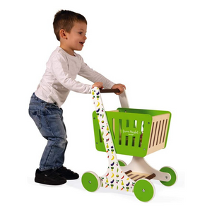 Child playing with wooden shopping cart