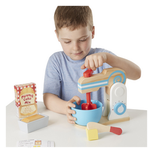 Child playing with Make a Cake Mixer