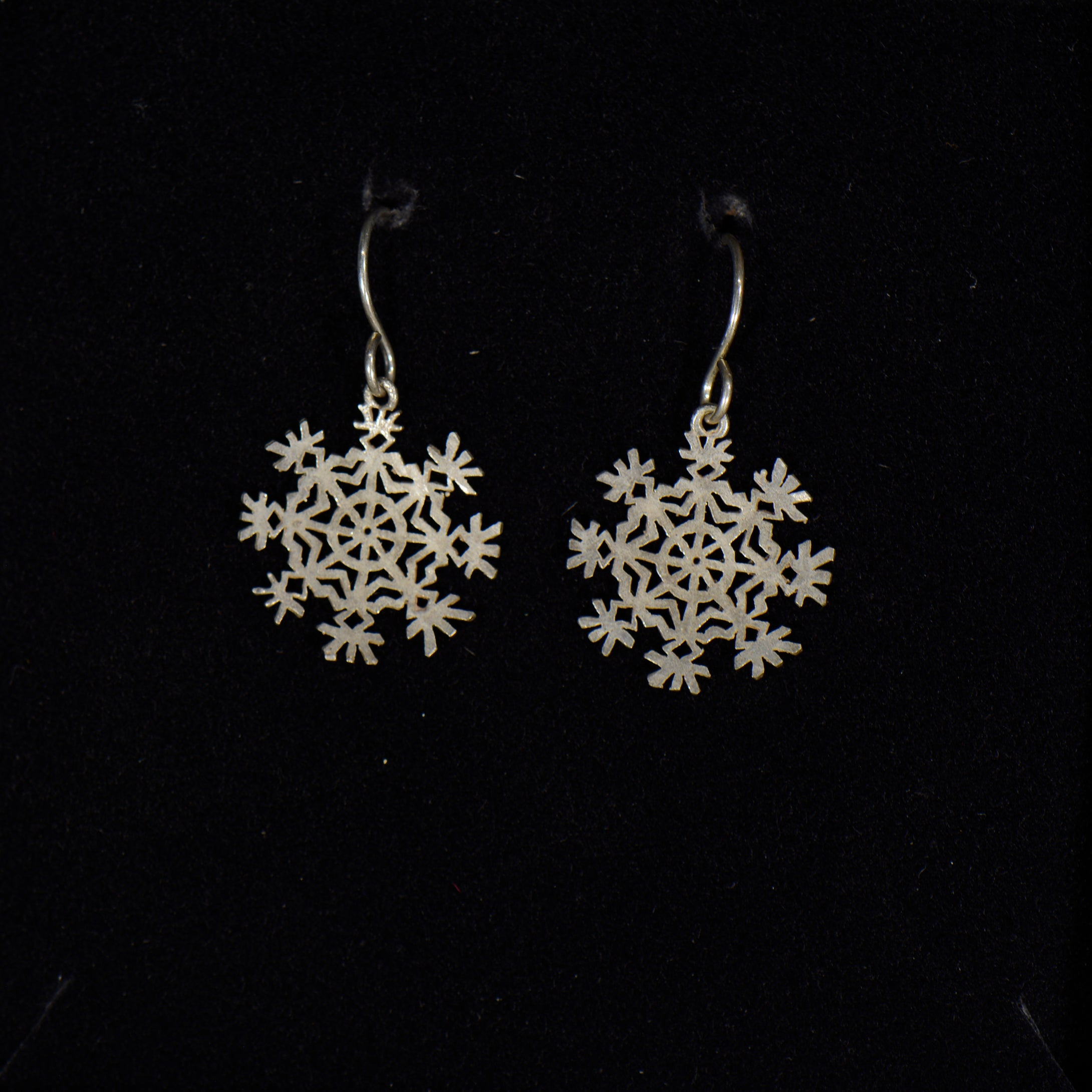 Silver snowflake earrings.