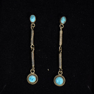 Silver and turquoise earrings.