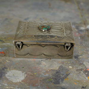 Silver and turquoise box.