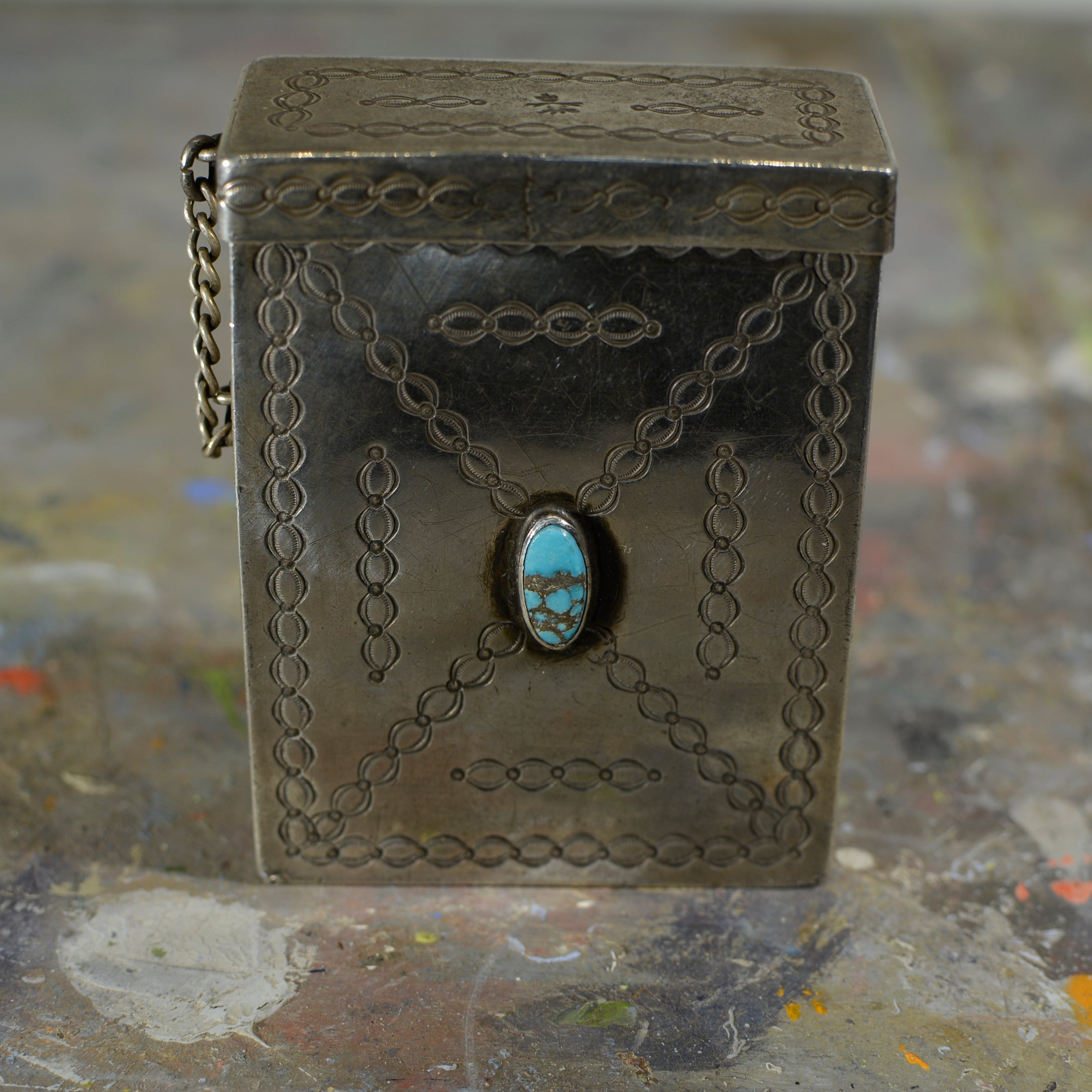 Silver and turquoise cigarette case.