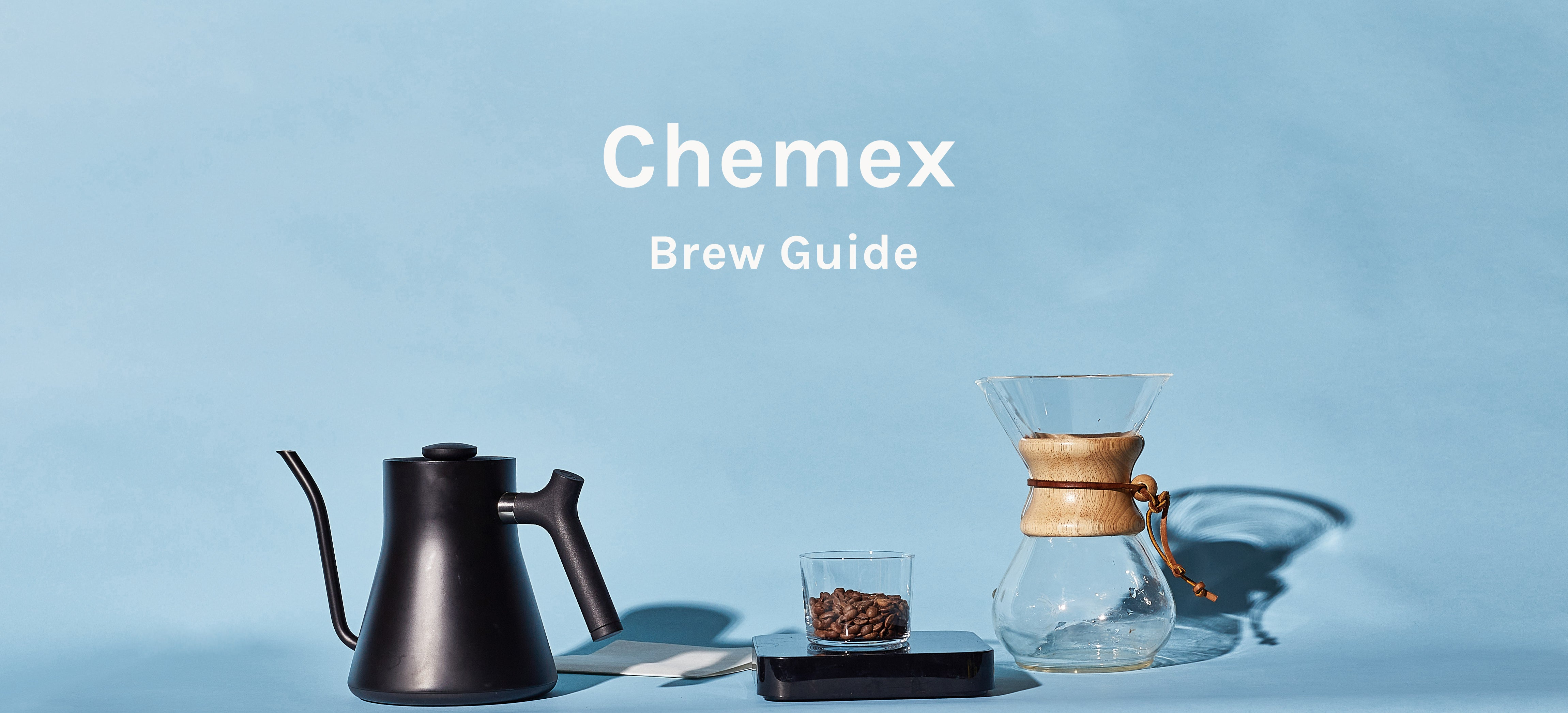 Chemex, Kettle, scale, and beans on blue background