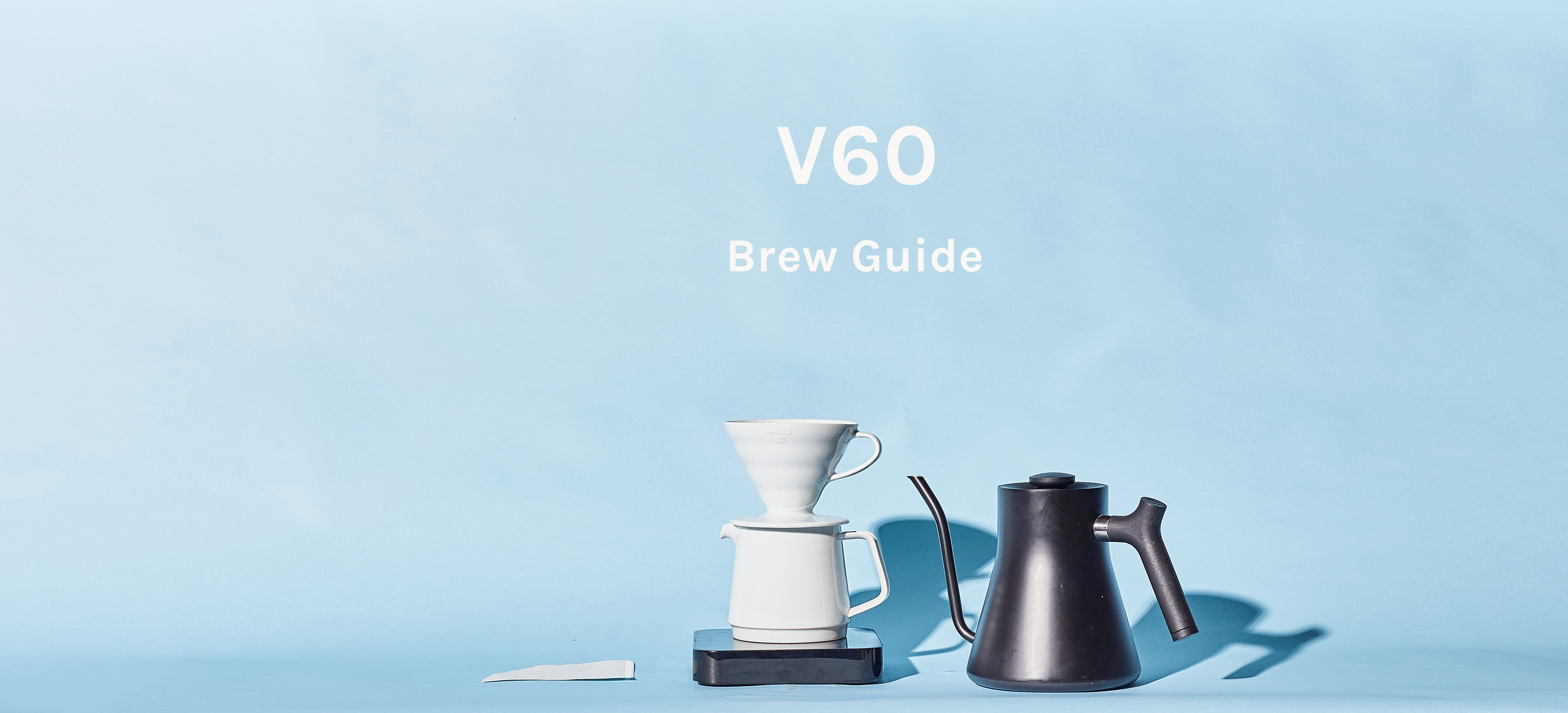 V60, Kettle, scale, and beans on blue background