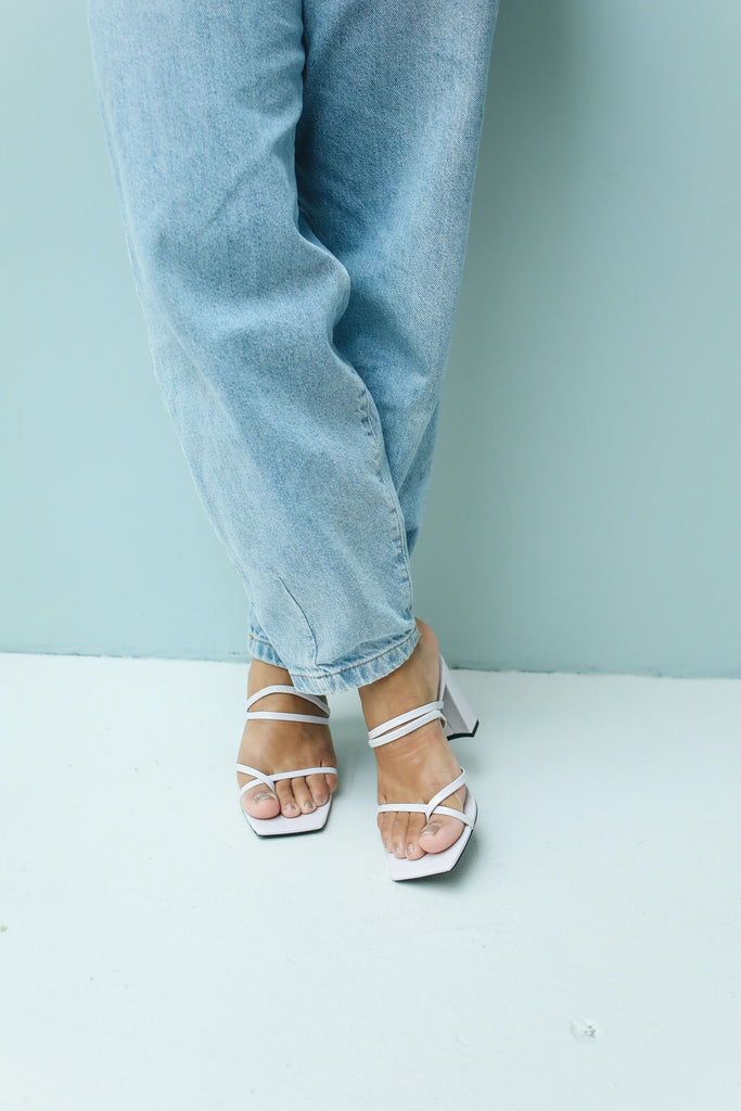 Slouchy jeans paired with Square toe heels