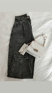 Gray Slouchy jeans and beige top handle sholder bag