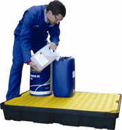 Man pouring chemicals into container on poly spill tray