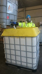 IBC Spill Saver being used by man in PPE
