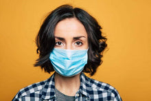 Load image into Gallery viewer, Woman wearing 3ply disposable face mask orange background for PPE Starter kit