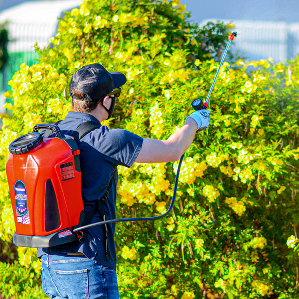 Man using Tomahawk's 4.75 Gallon Battery Powered Backpack Sprayer for Pest Control