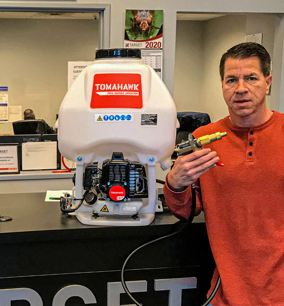 Bobby Shoffner, Target Specialty Sale Representive from Dallas/Fort Worth, with a Tomahawk 5 Gallon Mortorized Backpack Sprayer and Foundation Gun Attachment.