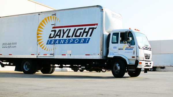 daylight freight truck power screed shipping