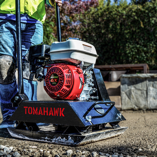 Construction crew using a Tomahawk Power plate compactor