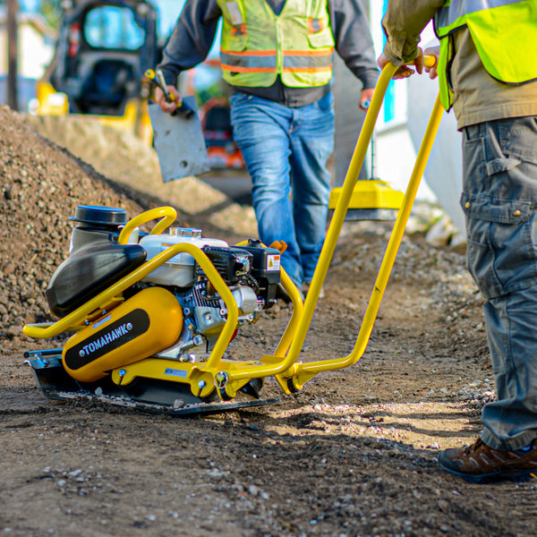 Man using a 5.5 HP Honda Plate Compactor Tamper Asphalt Compaction from Tomahawk Power