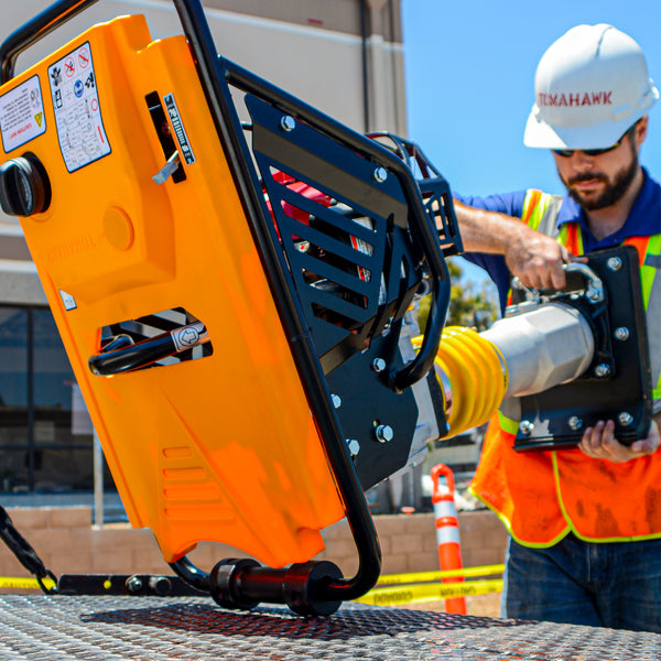 Construction worker using 3 HP Honda Vibratory Rammer Tamper with Honda GX100 Engine 3350 lbs/ft from Tomahawk Power