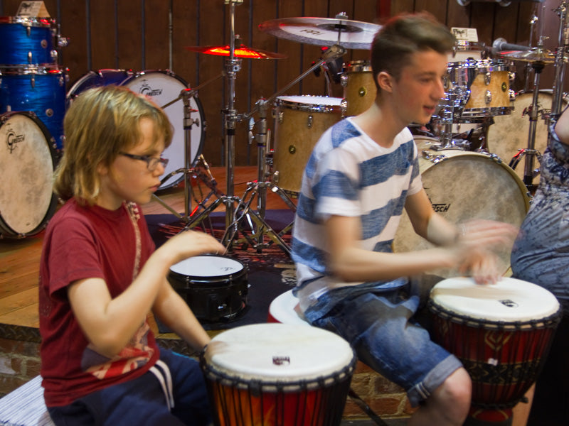 Cool drummers playing at drum shop UK