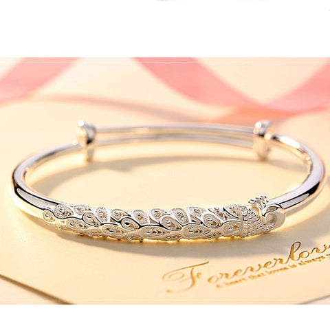 products/Silver_Bangle_Peafowl_Feather_Engraved_Ethhnic_push_closure_blingever.jpg