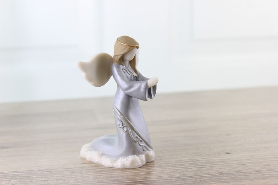 Sympathy angel figurine is accented with gold and silver details. From Think Pray Gift
