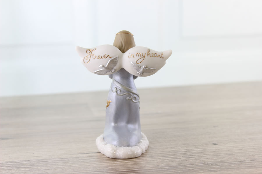 Forever in my Heart is inscribed on the wings of this sympathy angel figurine from Think Pray Gift.